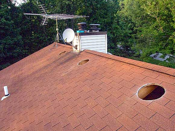 Red Shingle Sloped Roof With Hole For Vent Installation