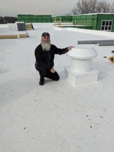 Martin Kolt Standing Next To The Pop Vent With A Curb Mount Flange - Installed On A Wooden Roof Curb