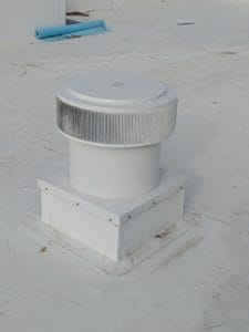 Flat Roof Ventilation - Aura Ventilator With Curb Mount Flange On A Roof Curb